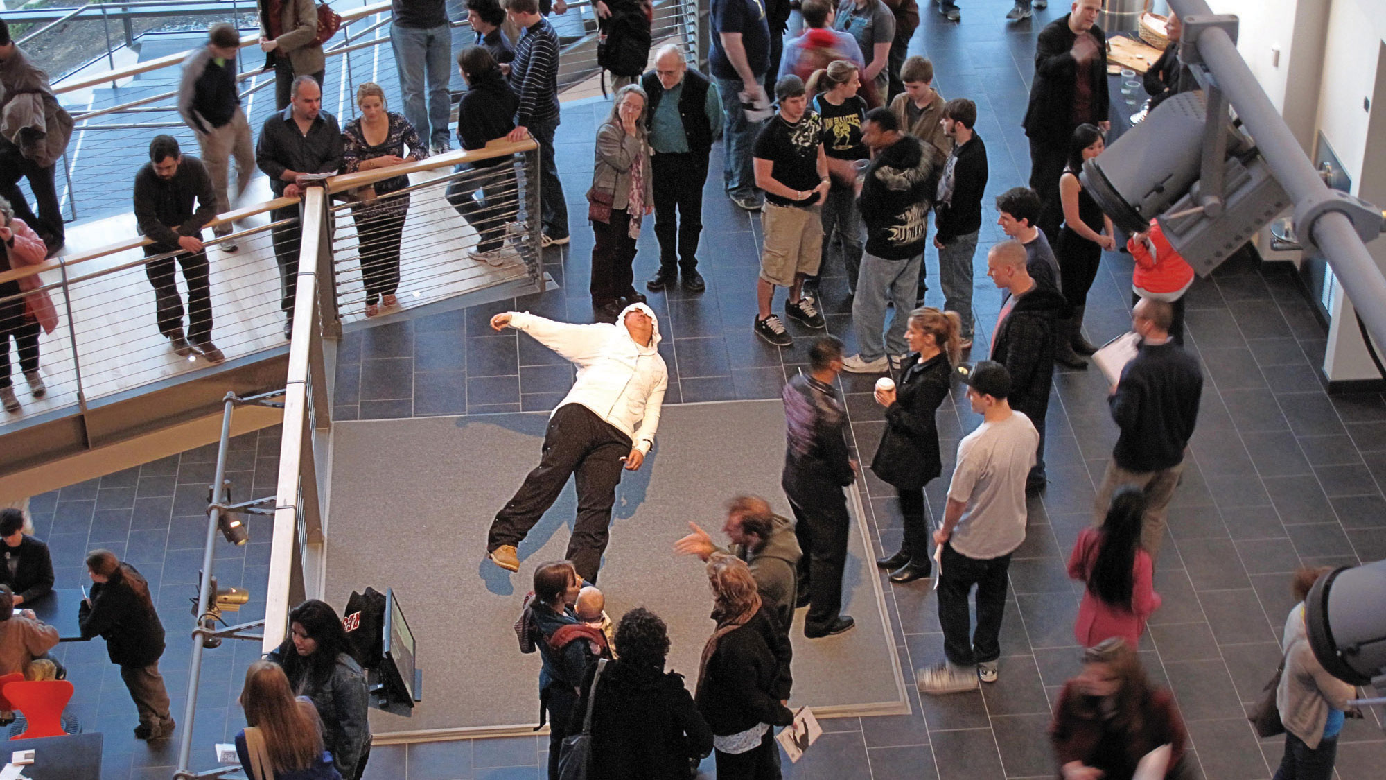 people in the mezzanine during an exhibition opening