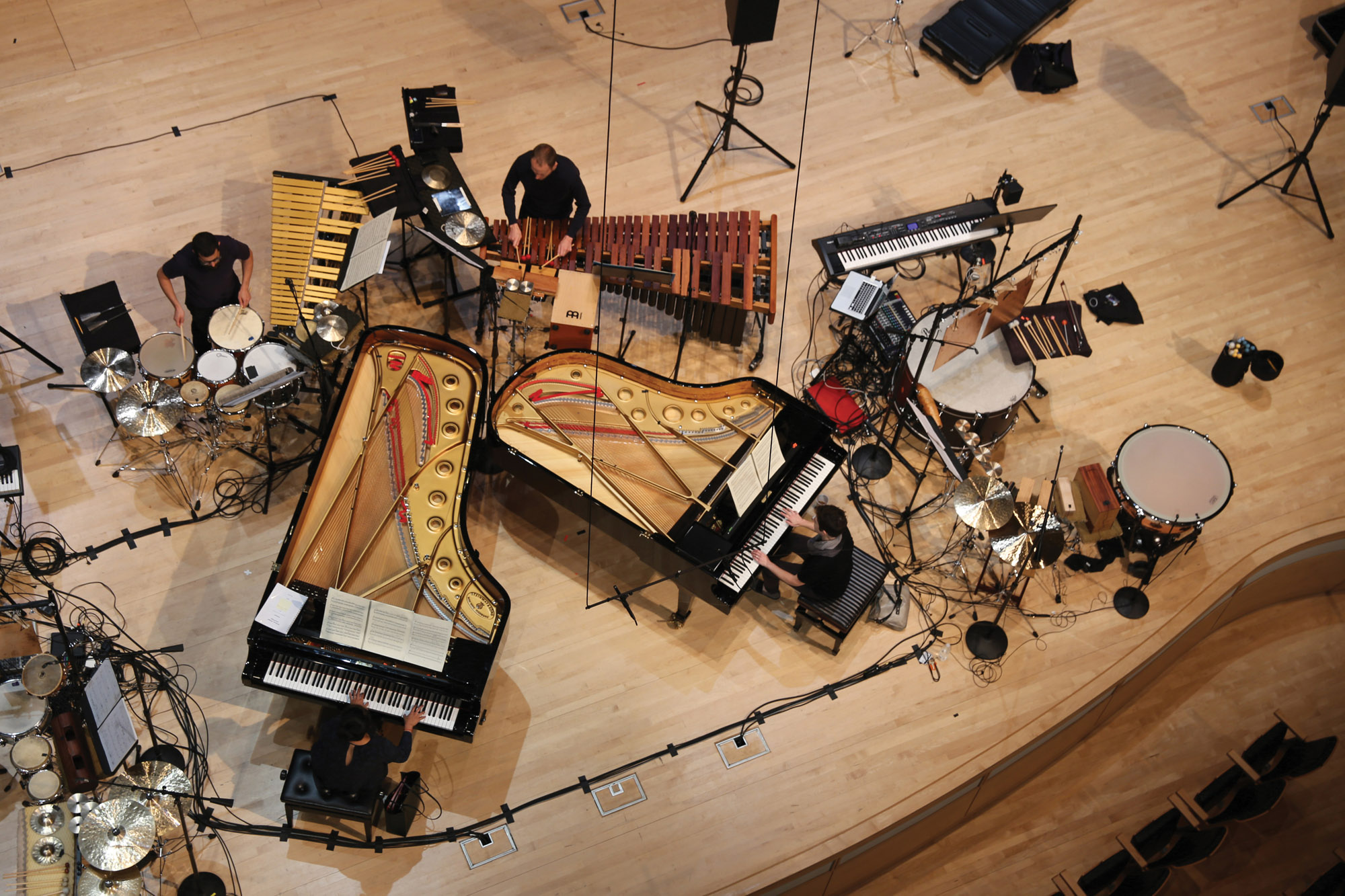 two pianos as viewed from directly above the concert hall stage.