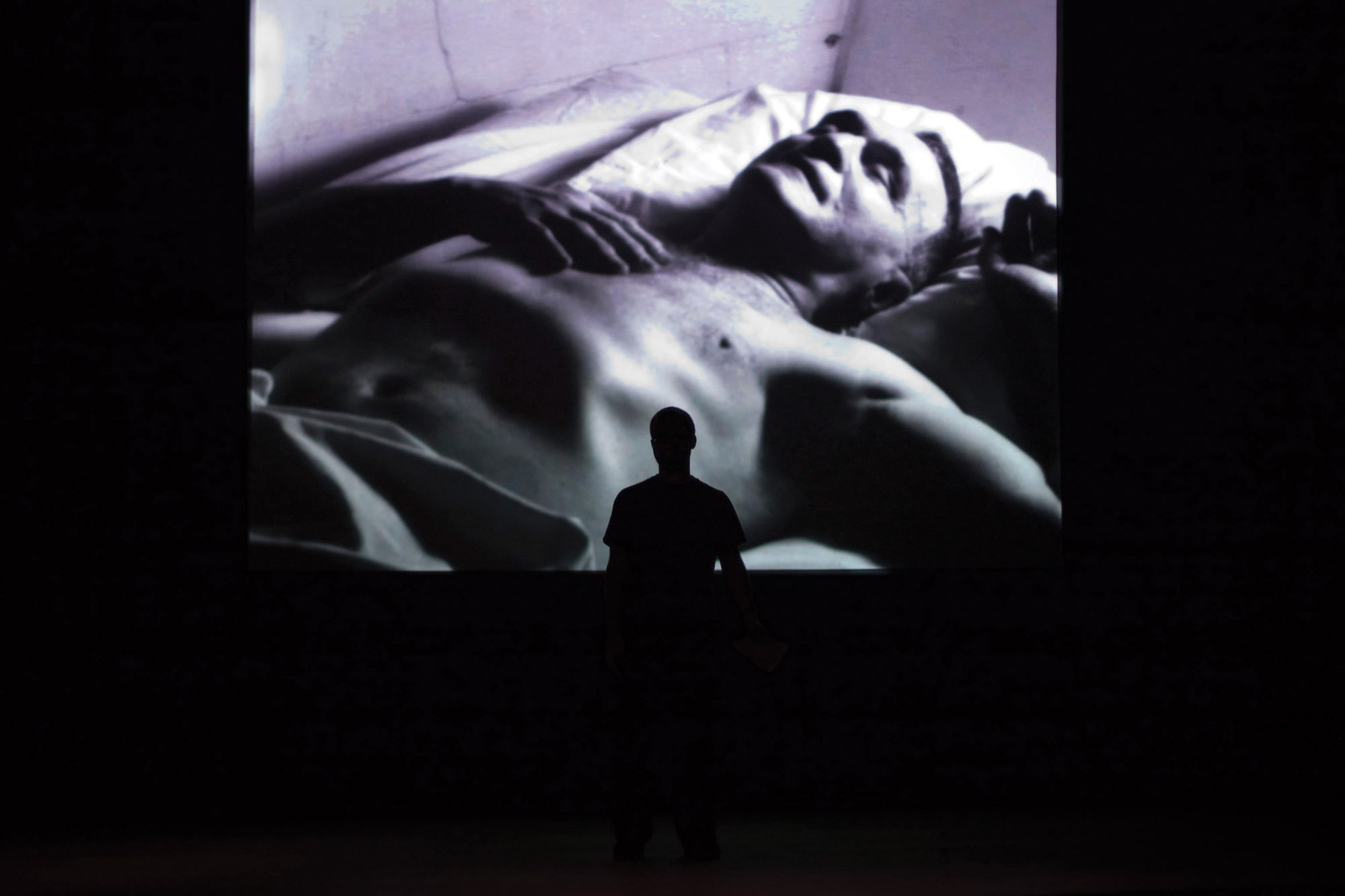 a projection of a man sleeping