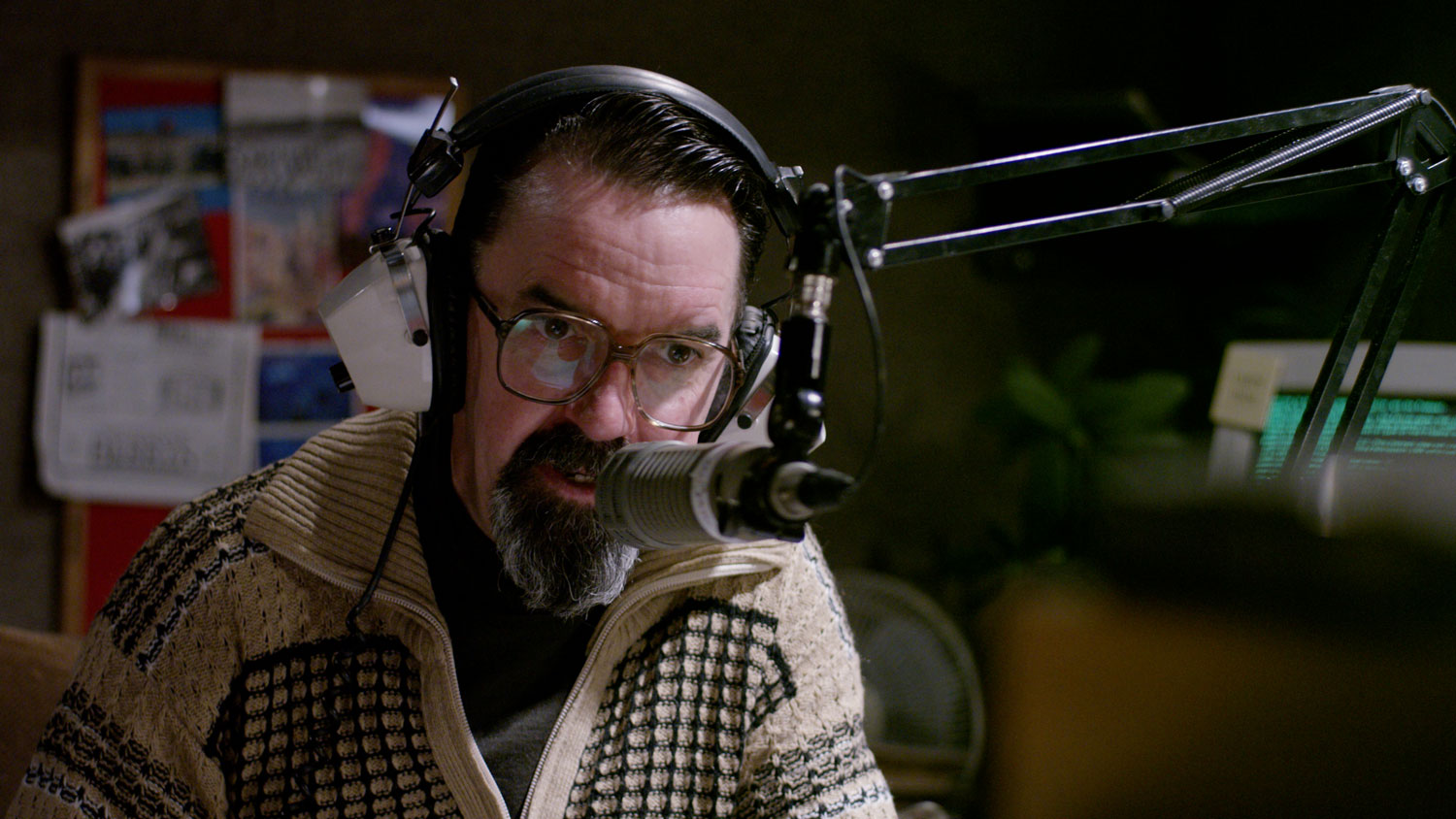a man in a radio studio with a headset on