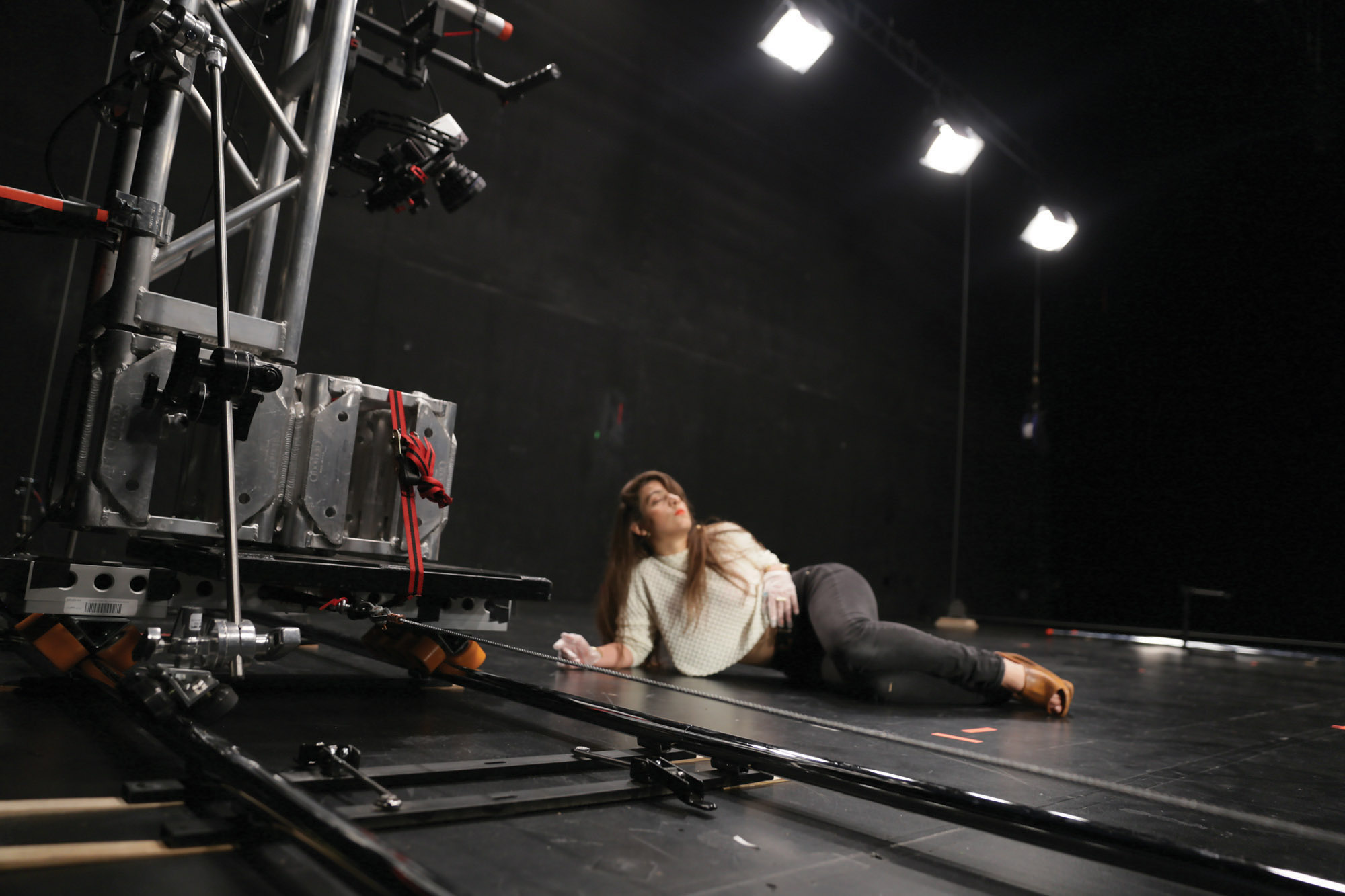 a woman laying on stage.