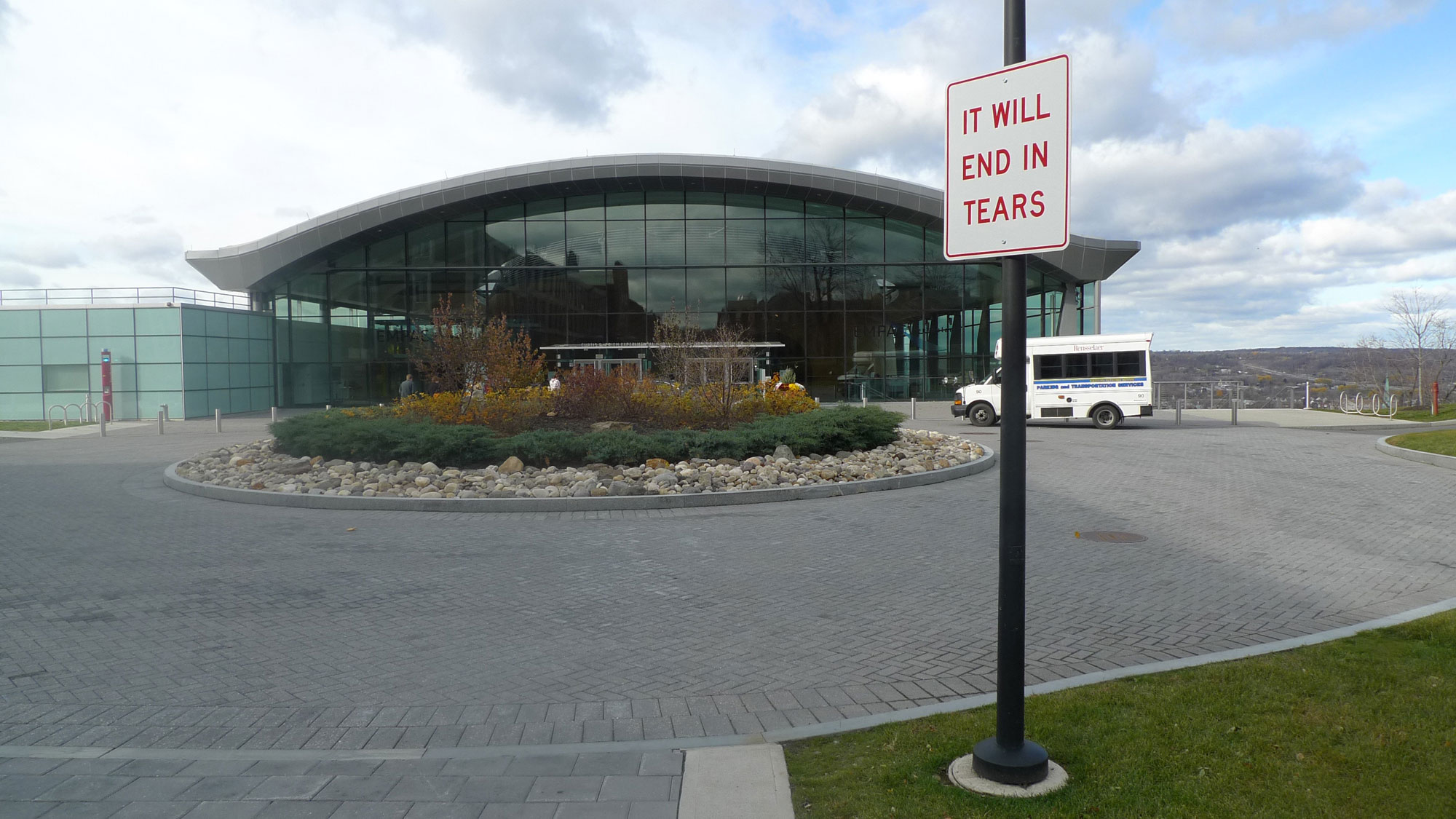 "a street sign in front of empac reads ""it will end in tears"""