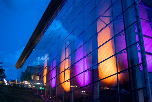 the empac north facade lit up purple and gold