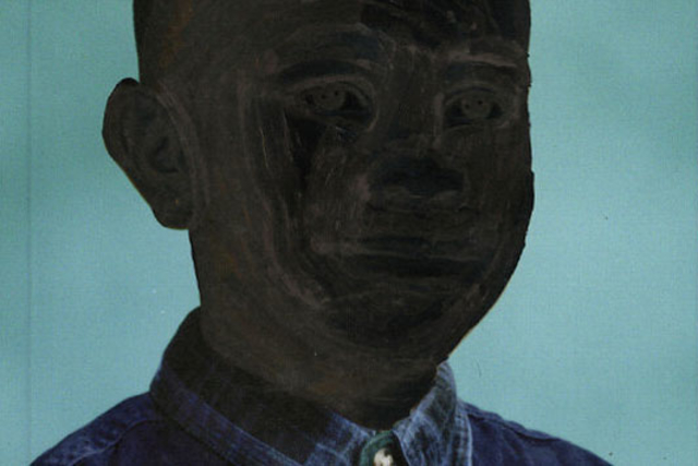 an illustration of a young black man in a denim shirt on a book cover