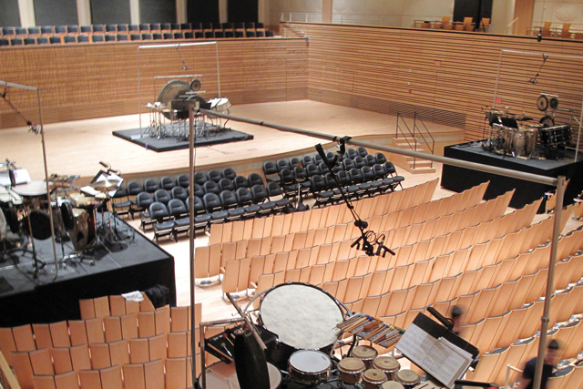 multiple drum sets circularly arranged in the concert hall