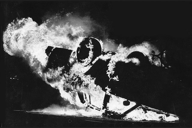 an image of a burning car