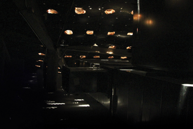 light filtering into a void under the theater  — the star room