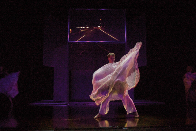 a man dances with flowing white robes